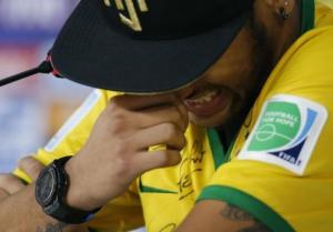 Injured Brazilian national soccer team player Neymar cries during a news conference in Teresopolis